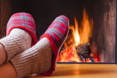 Relaxing at the fireplace on winter evening stock images