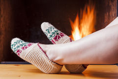 Relaxing at the fireplace on winter evening Royalty Free Stock Photography