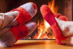 Relaxing at the fireplace on winter evening Stock Photo