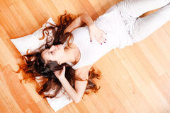 Relaxing on the floor Royalty Free Stock Photos