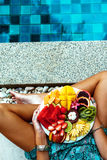 Relaxing with fruits by the pool Stock Photography