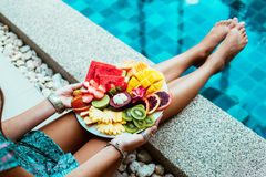 Relaxing with fruits by the pool Royalty Free Stock Images