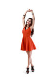 Relaxing. Full height portrait of relaxing young asian woman hand up stretching herself, Isolated over white with clipping path stock photography