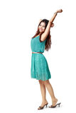 Relaxing. Full height portrait of relaxing young asian woman hand up stretching herself, Isolated over white with clipping path royalty free stock photo