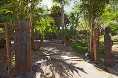 Relaxing garden with Buddhist statues royalty free stock images