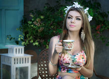 Relaxing In The Garden And Drinking A Cup Of Coffee Stock Image