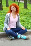 Relaxing ginger girl on skates Stock Photography