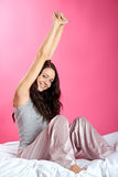 Relaxing girl in bed Royalty Free Stock Photo