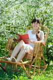Relaxing  girl   in bloom garden Royalty Free Stock Photography