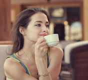 Relaxing girl with cup of coffee Royalty Free Stock Photos