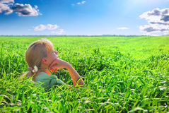 Relaxing girl on meadow. Against the blue sky Stock Photo
