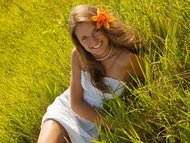 Relaxing girl  on meadow grass Royalty Free Stock Photography