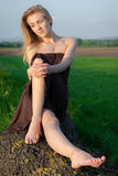 Relaxing girl outdoors. Beautiful girl relaxing and enjoying the life outdoors Stock Image