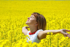 Relaxing girl in the rapeseed field Royalty Free Stock Photos