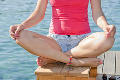 Relaxing girl in yoga position - detail Royalty Free Stock Photos