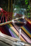 Relaxing with a glass of wine. Recipe happiness is as a glass of wine and a hammock royalty free stock images
