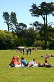 Relaxing in Golden Gate Park. A group of friends chat while sitting in Golden Gate Park in San Francisco Stock Photo