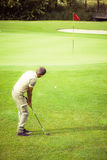 Relaxing golf green Stock Photos