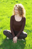 Relaxing in the grass. Beautiful young woman relaxing in the grass stock photos