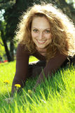Relaxing in the grass. Beautiful young woman relaxing in the grass stock photography