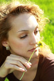 Relaxing in the grass. Beautiful young woman relaxing in the grass royalty free stock image