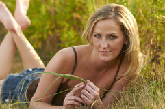 Relaxing In Grass Royalty Free Stock Photography