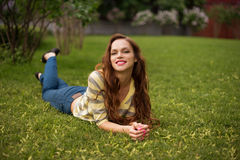 Relaxing in grass stock photography