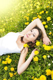 Relaxing in the grass and flowers Royalty Free Stock Photo