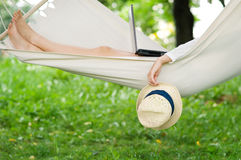 Relaxing on hammock. Young woman relaxing on hammock Royalty Free Stock Image