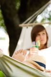 Relaxing on hammock. Young woman relaxing on hammock Stock Photo