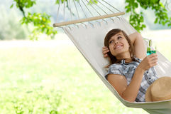 Relaxing on hammock. Young woman resting on hammock Stock Photos
