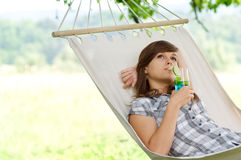 Relaxing on hammock. Young woman resting in hammock Royalty Free Stock Photos