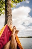Relaxing in the hammock at the beach under trees, summer day Royalty Free Stock Photos