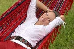 Relaxing in hammock. Beautiful woman relaxing in hammock Stock Photos