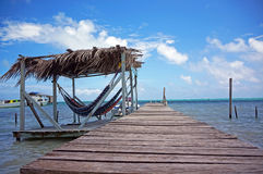 Relaxing Hammock on the Dock royalty free stock images