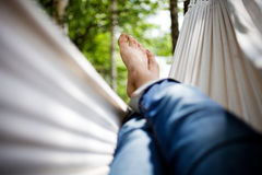 Relaxing in hammock. Woman relaxing in white hammock Royalty Free Stock Photography