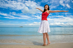 Relaxing happy girl. A happy and relaxing girl by the seaside Royalty Free Stock Image