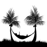 Relaxing after a hard days work. Relaxing in a hammock at the beach after a hard days work Stock Photo