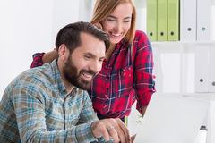 Relaxing and having fun at work Stock Image