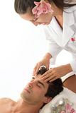 Relaxing Head Massage. A man receives relaxing head and neck massage at a salon or day spa Stock Photography