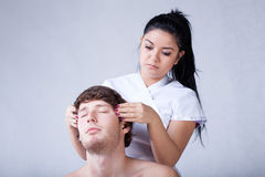 Relaxing head massage Stock Images
