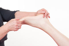 Relaxing healthy foot massage close up Royalty Free Stock Images