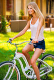 Relaxing with her bicycle. Stock Image