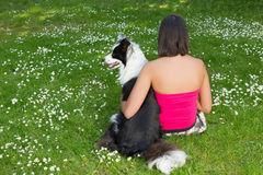 Relaxing with her dog Royalty Free Stock Image