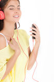 Relaxing with her favourite music. Royalty Free Stock Photography
