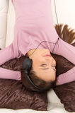 Relaxing with her favourite music. Royalty Free Stock Images