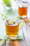 Relaxing herbal tea with linden flower Stock Images