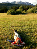 Relaxing in The High Tatras. Relaxing man in The High Tatras in Slovakia at sunset stock images