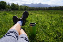 Relaxing after a hike in ireland. Relaxing with some tea in a thermal cup after a hike in killarney Royalty Free Stock Photos