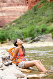 Relaxing hiker woman resting feet in river hiking Stock Photos